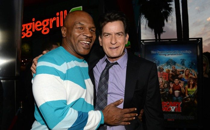 Mike tyson the scary movie 5 interview conducted by kam mike tyson pictured with scary movie 5 co star charlie sheen at the films premiere m4hsunfo